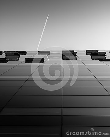 Free The Glass Facade Of The Royal Library/the Black Diamond, Copenhagen, With The Trail Of A Plane Above. Royalty Free Stock Photos - 119912998