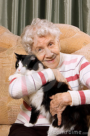 Free The Grandmother With A Cat On A Sofa Royalty Free Stock Images - 18890399