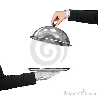 Free The Hand Of The Waiter Holding Cloche Over Empty Stock Photo - 70116080