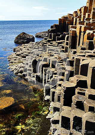 Free The Hexagonal Basalt Slabs Of Giants Causeway Dipping Into The Sea Royalty Free Stock Photography - 35309857