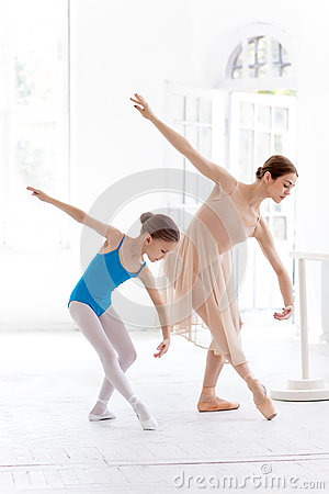 Free The Little Ballerina Posing At Ballet Barre With Personal Teacher In Dance Studio Royalty Free Stock Photography - 57267477