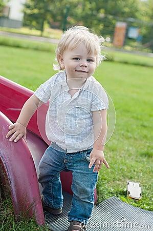 Free The Little Boy Standing Near Children S Slides Stock Image - 29677201
