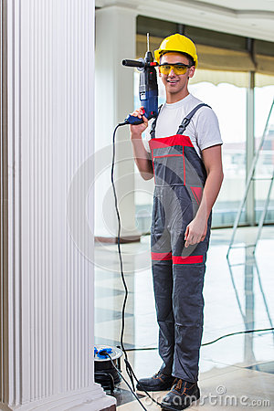 Free The Man Drilling The Wall With Drill Perforator Stock Photography - 74351482