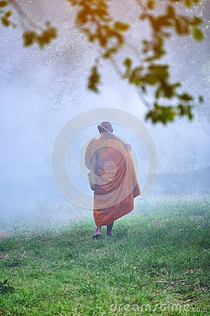 Free The Monk Walks In The Forest, Buddhist Temple, Novice Monk Went Royalty Free Stock Photo - 110936935
