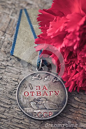 Free The Old Soviet Medal For Bravery Of The Second World War With A Red Carnation, Victory Day May 9 Postcard Concept Royalty Free Stock Images - 111343889
