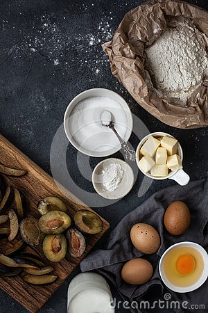 Free The Process Of Making Home Made Plum Pie. Pie`s Ingredients On Table On Dark Background. Stock Photos - 128283403