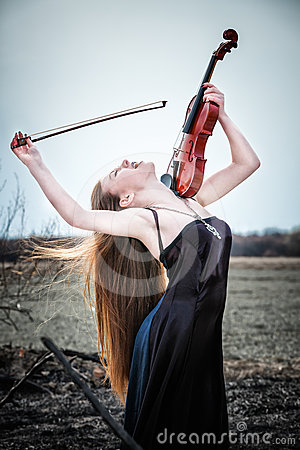 Free The Red-haired Girl With A Violin Stock Photo - 24307420