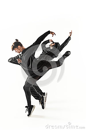 Free The Silhouettes Of Two Hip Hop Male And Female Break Dancers Dancing On White Background Royalty Free Stock Photo - 89590935
