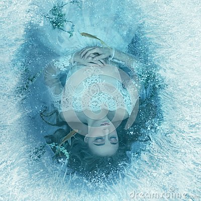 Free The Story Of A Sleeping Beauty. The Girl Is Sleeping On The Bottom Of A Frozen Lake, Fish And Seaweed Are Swimming Stock Images - 114338094