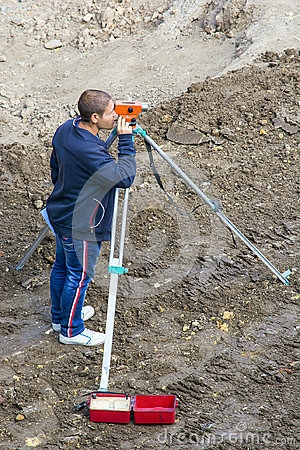 Free The Surveyor Makes Measurements With The Help Of A Level. Workplace Royalty Free Stock Photography - 98029907