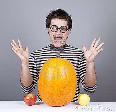 Free The Young Mad Men Try To Eat Apples And Pumpkin. Royalty Free Stock Photo - 16755855