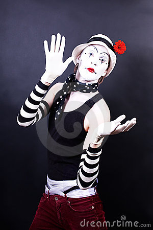 Theatrical mime in white hat with red flower