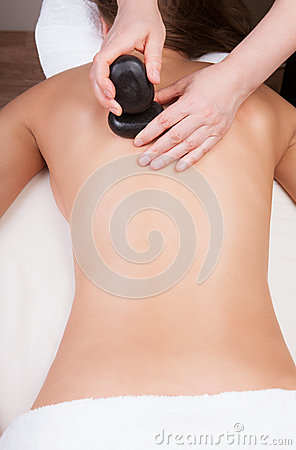 Therapist doing hot stone massage