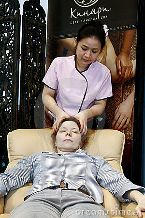 Therapist doing massage Editorial Stock Photo
