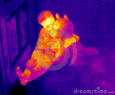 Thermal image of boy holding  teddy bear