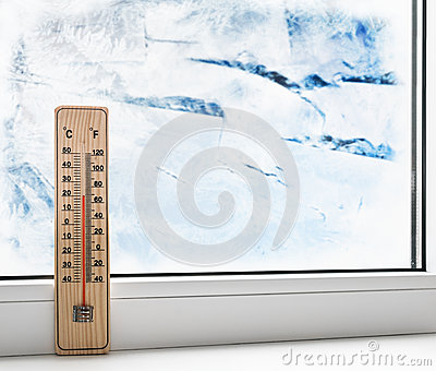 Thermometer on a frozen window and cold weather stock for Windows for cold climates