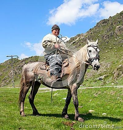Thick dirty man on horseback