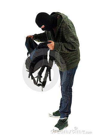 Thief in  balaclava with stolen backpack