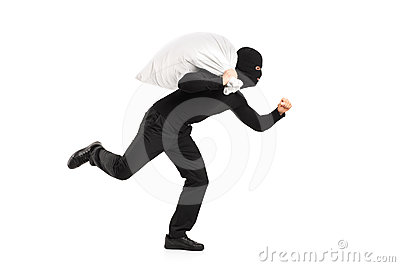 Thief carrying a bag and running away