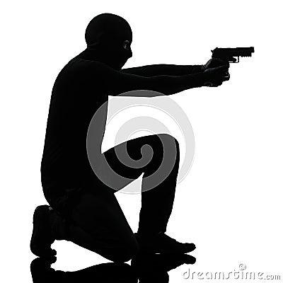 Thief criminal terrorist aiming gun man