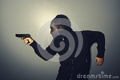 Thief with gun stealing