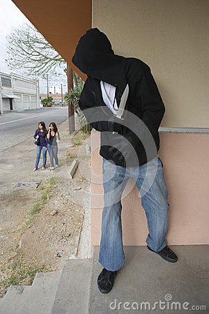 Thief Hiding Behind Wall Looking At Girls