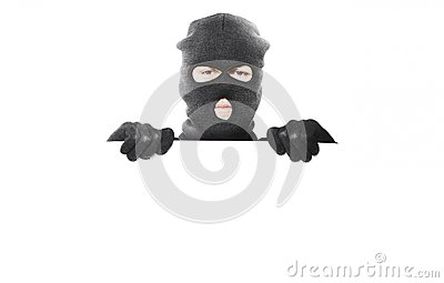 Thief with robbery mask holding blank white board
