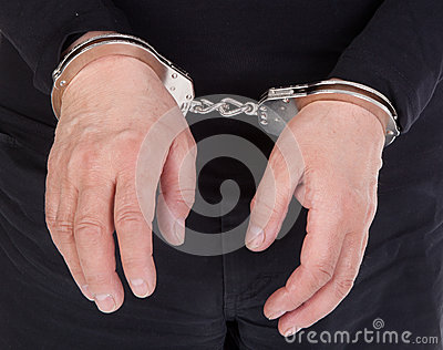 Thief s hands in handcuffs