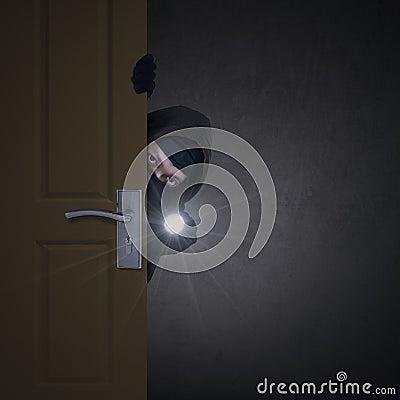 Free Thief Sneaking Through Door Stock Photography - 41593062