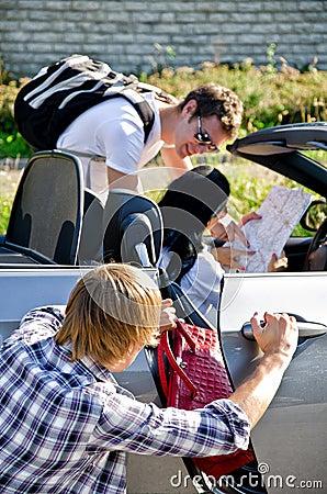 Thief stealing handbag from the car