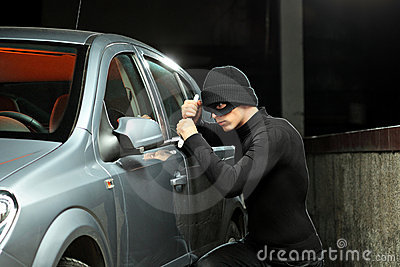 Thief trying to steal an automobile