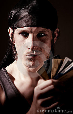 Free Thief With Credit Cards Royalty Free Stock Photography - 12125077