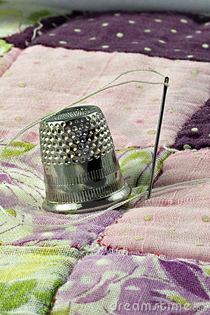 Thimble and patchwork quilt