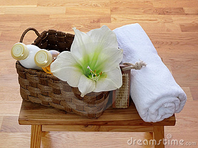 Things for body care in basket and towel