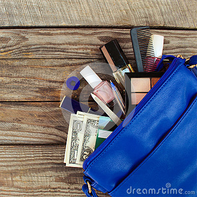 Free Things From Open Lady Handbag. Women S Purse On Wood Background Royalty Free Stock Images - 66442269