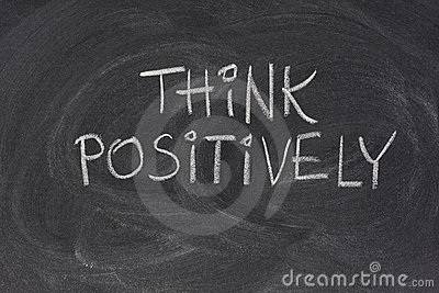 Think positively slogan on blackboard