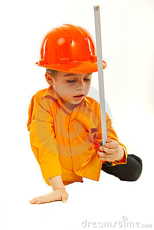Thinking boy holding measure tool