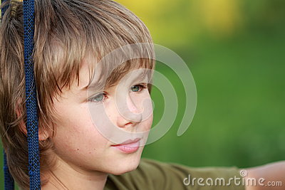Thinking boy with smile