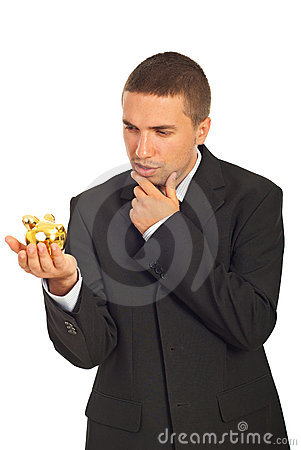 Thinking business man holding piggy bank