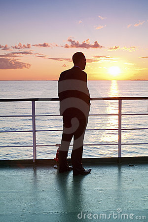 Free Thinking Businessman And Red Sunset On A Ferry Royalty Free Stock Images - 20839329