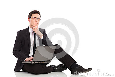 Thinking businessman with laptop.