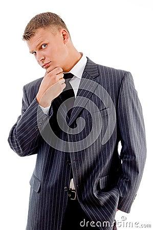 Thinking businessman looking at camera