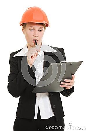 Thinking businesswoman in a helmet