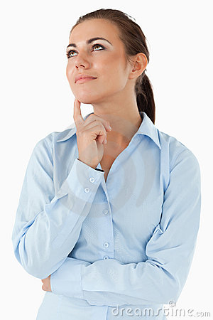Thinking businesswoman looking diagonally upwards
