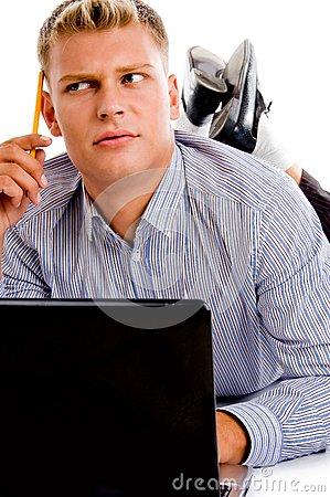 Thinking man with laptop and pencil