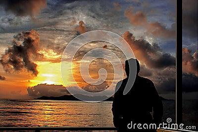Thinking man on sea sunset .