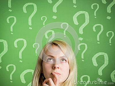 Thinking woman in front of blackboard with questio