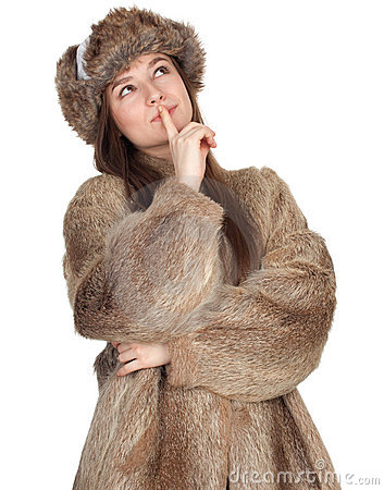 Thinking woman in a fur coat and hat
