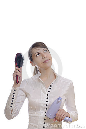 Thinking woman with hairbrush and dryer