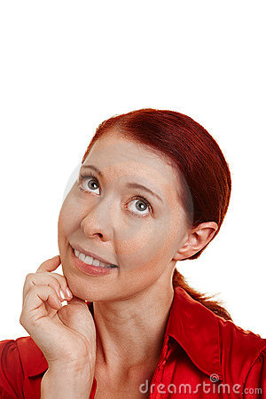 Thinking woman with hand on chin